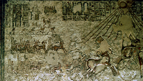 Akenaten drives his chariot on the Royal Road