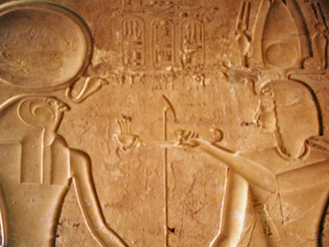 Seti II offers incense to a hawk-headed god