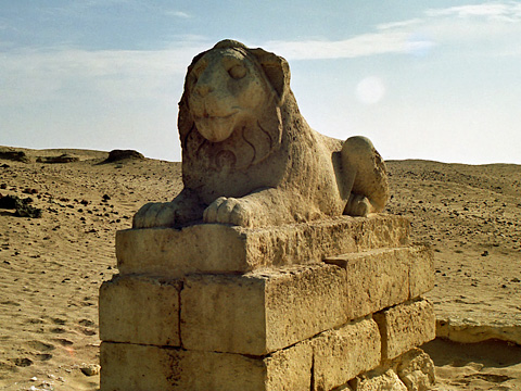 Greek lion statue at the temple entrance