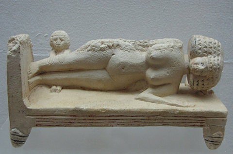 Roman lady asleep on a couch